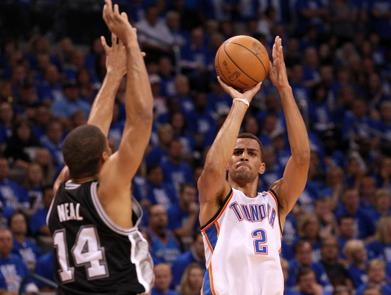 OKLAHOMA CITY, OK - MAY 31:  Thabo Sefolosha #2 of the Oklahoma City Thunder shoots over Gary Neal #14 of the San Antonio Spurs in the third quarter in Game Five of the Western Conference Finals of the 2012 NBA Playoffs at Chesapeake Energy Arena on May 31, 2012 in Oklahoma City, Oklahoma. NOTE TO USER: User expressly acknowledges and agrees that, by downloading and or using this photograph, User is consenting to the terms and conditions of the Getty Images License Agreement.  (Photo by Ronald Martinez/Getty Images)