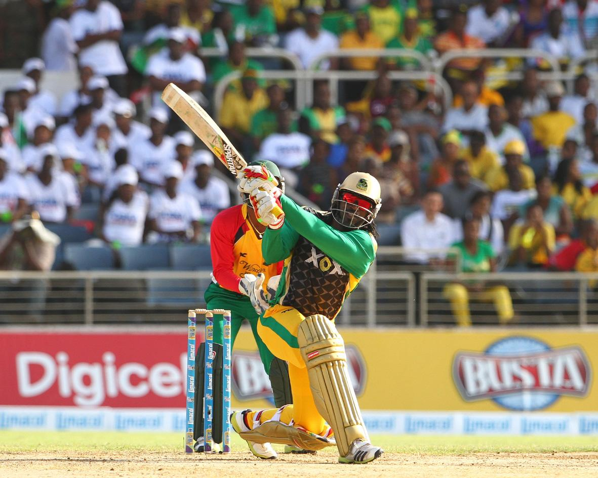 KINGSTON, JAMAICA - AUGUST 15: Chris Gayle hits a massive six down the ground during the Sixteenth Match of the Cricket Caribbean Premier League between Jamaica Tallawahs v Guyana Amazon Warriors at Sabina Park on August 15, 2013 in Kingston, Jamaica. (Photo by Ashley Allen/Getty Images Latin America for CPL)