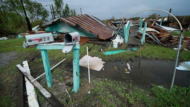PHOTO: Storm clouds from Tropical Storm Nicholas are seen behind homes in the Native American community of Isle de Jean Charles, La., which were destroyed by Hurricane Ida, Sept. 14, 2021. (Gerald Herbert/AP)