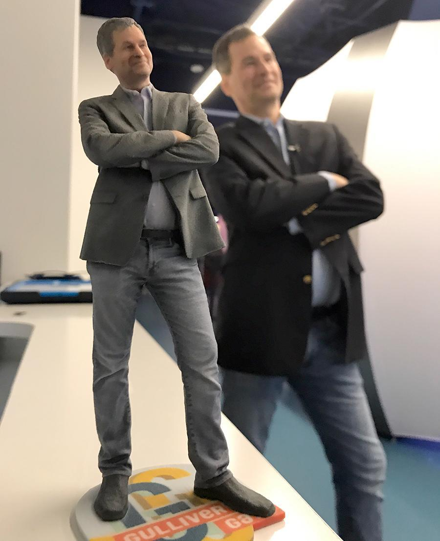 The 3-D printed Medium Me (foreground) captures me at this age, and in this pose, forever.