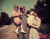 <p>Princess Anne had her dad wrapped around her little finger when the young royals posed with their new family in 1951. Anne is held by the Queen, while Philip holds a young Charles. Photo: Getty Images.</p>