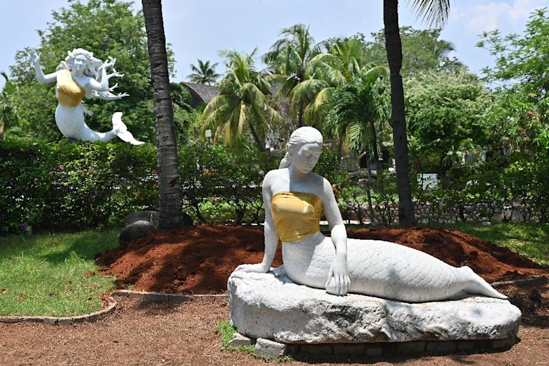 The bare chests of two mermaid statues have been covered up at an Indonesian theme park (AFP Photo/ADEK BERRY)