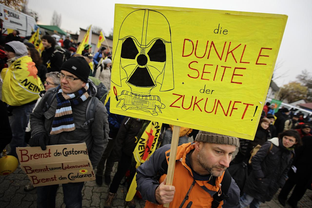 Anti-nuclear protestors arrive for a demonstration against the transport of Castor nuclear waste containers in Berg near the German French border in south-west Germany, November 24, 2011. The shipment of Castor containers is on its way to the intermediate nuclear storage facility in the north-eastern German town of Gorleben. The text on placard reads 'The dark side of future.'  REUTERS/Kai Pfaffenbach (GERMANY - Tags: ENVIRONMENT CIVIL UNREST POLITICS)