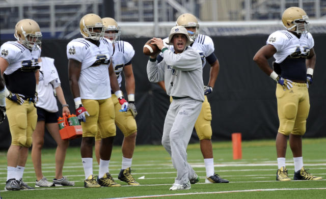 FILE - In this Aug. 22, 2013 file photo, Notre Dame defensive coordinator Bob Diaco works with the defense during NCAA college football practice in South Bend, Ind. Connecticut has hired Notre Dame defensive coordinator Bob Diaco as its football coach. The school announced the move early Thursday morning, Dec. 12, 2013. (AP Photo/Joe Raymond, File)