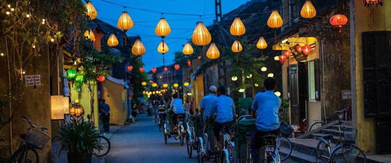 Night view of busy street in Hoi An, Vietnam. Hoi An is the World's Cultural heritage site, famous for mixed cultures and architecture.