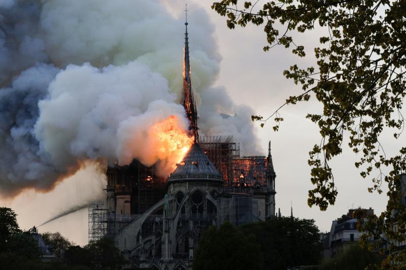 Flames and smoke are seen billowing from the roof at Notre-Dame Cathedral in Paris on April 15, 2019. - (GEOFFROY VAN DER HASSELT via Getty Images)