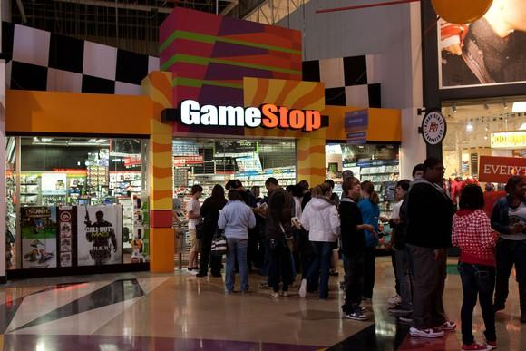 Crowds line up outside a GameStop ahead of a release party.