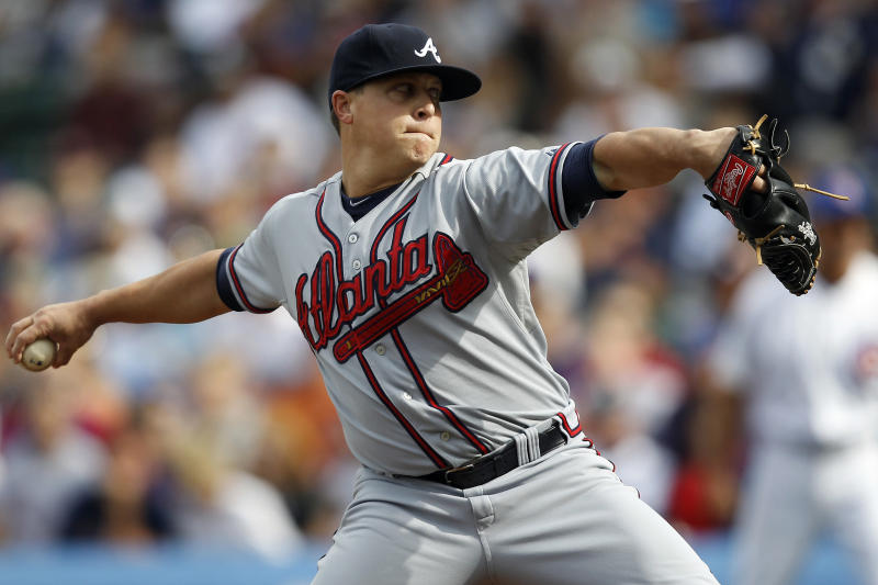 Atlanta Braves starting pitcher Kris Medlen delivers against the Chicago Cubs during the first inning of a baseball game on Saturday, Sept. 21, 2013, in Chicago. (AP Photo/Andrew A. Nelles)