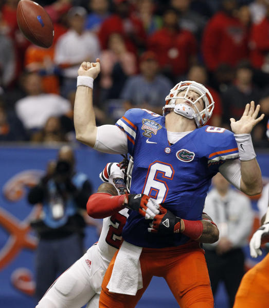 Louisville safety Calvin Pryor (25) causes Florida quarterback Jeff Driskel (6) to fumble the ball during the second half of the Sugar Bowl NCAA college football game Wednesday, Jan. 2, 2013, in New Orleans. Louisville recovered and scored on the next play. (AP Photo/Butch Dill)