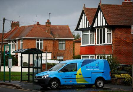 FILE PHOTO: A British Gas van is seen parked outside a home in Loughborough, central England October 17, 2013. REUTERS/Darren Staples/File Photo