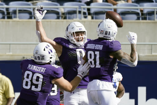 Northwestern tight end John Raine (0) celebrates his touchdown on a reception against Auburn with teammate tight end Charlie Mangieri (89) and wide receiver Ramaud Chiaokhiao-Bowman (81) during the first half of the Citrus Bowl NCAA college football game, Friday, Jan. 1, 2021, in Orlando, Fla. (AP Photo/John Raoux)