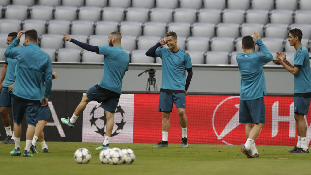 Real Madrid's Cristiano Ronaldo, center, jokes with team mates during a training session in Munich, Germany, Tuesday, April 24, 2018. FC Bayern Munich will face Real Madrid for a Champions League semi final first leg soccer match in Munich on Wednesday, April 25, 2018. (AP Photo/Matthias Schrader)