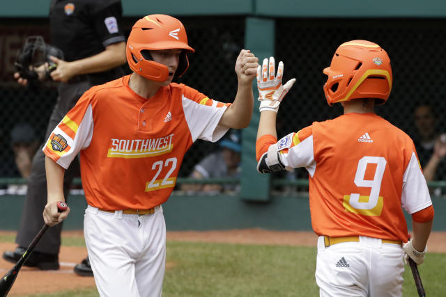 River Ridge, Louisiana's Reece Roussel (22) celebrates with Conner Perrot after scoring on a double by Marshall Louque off Curacao pitcher Keven Rosina during the third inning if the Little League World Series Championship game in South Williamsport, Pa., Sunday, Aug. 25, 2019. (AP Photo/Gene J. Puskar)
