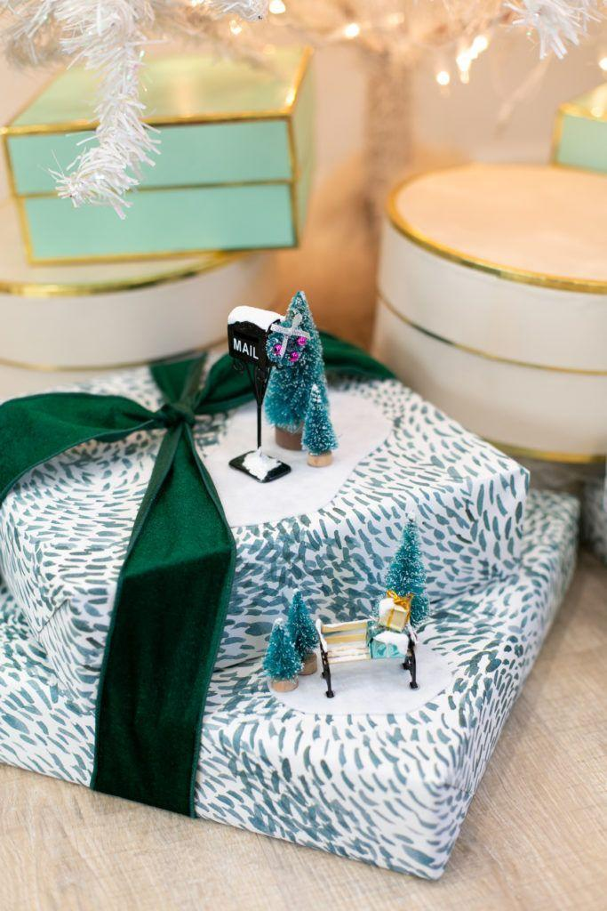 """<p>Once gifts are wrapped, use little figurines—bottle brush trees and seasonal dollhouse furniture—to create sweet snowy vignettes. </p><p>Get the tutorial at <a href=""""https://lovelyindeed.com/holiday-gift-wrapping-idea-with-miniature-winter-scenes/"""" rel=""""nofollow noopener"""" target=""""_blank"""" data-ylk=""""slk:Lovely Indeed"""" class=""""link rapid-noclick-resp"""">Lovely Indeed</a>.</p><p><a class=""""link rapid-noclick-resp"""" href=""""https://www.amazon.com/Etmact-Multicolor-Ornaments-Displaying-Decoration/dp/B07R39PDZT?tag=syn-yahoo-20&ascsubtag=%5Bartid%7C10072.g.34015639%5Bsrc%7Cyahoo-us"""" rel=""""nofollow noopener"""" target=""""_blank"""" data-ylk=""""slk:SHOP BOTTLE BRUSH TREES"""">SHOP BOTTLE BRUSH TREES</a></p>"""