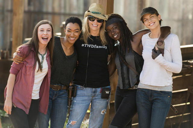 <p>Co-Executive Producer Denise Huth shows her series pride with a #TWDfamily T-shirt while surrounded by cast Katelyn Nacon, Sonequa Martin-Green, Danai Gurira, and Lauren Cohan.<br><br>(Photo: AMC) </p>