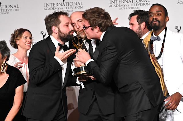 Fabio Porchat (R) poses in the press room with the award for Comedy for Especial do Natal Porta dos Fundos 'The Last Hangover' during the 2019 International Emmy Awards Gala (Credit: Dia Dipasupil/Getty Images)