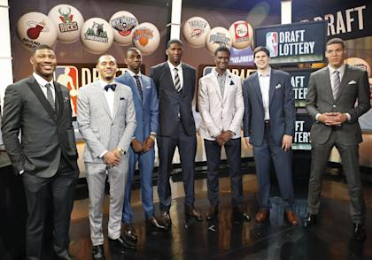 From left, NBA draft prospects Marcus Smart of Oklahoma State, Tyler Ennis of Syracuse, Andrew Wiggins and Joel Embiid of Kansas, Noah Vonleh of Indiana, Doug McDermott of Creighton and Aaron Gordon of Arizona during the draft lottery in May. (AP)