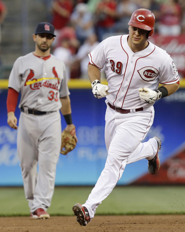 Cincinnati Reds' Devin Mesoraco (39) rounds the bases past St. Louis Cardinals second baseman Daniel Descalso (33) after Mesoraco hit a two-run home run off starting pitcher Jake Westbrook in the fourth inning of a baseball game, Saturday, Aug. 3, 2013, in Cincinnati. (AP Photo/Al Behrman)