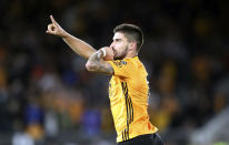 Wolverhampton Wanderers' Ruben Neves celebrates after scoring his side's opening goal during the English Premier League soccer match between Wolverhampton Wanderers and Manchester United at the Molineux Stadium in Wolverhampton, England, Monday, Aug. 19, 2019. (Nick Potts/PA via AP)