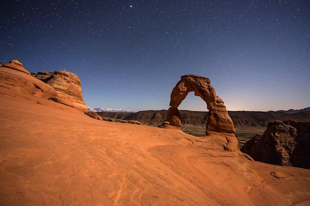 <p>The pictures show natural, freestanding red rock formations against the Milky Way. (Photo: Brad Goldpaint/Caters News) </p>
