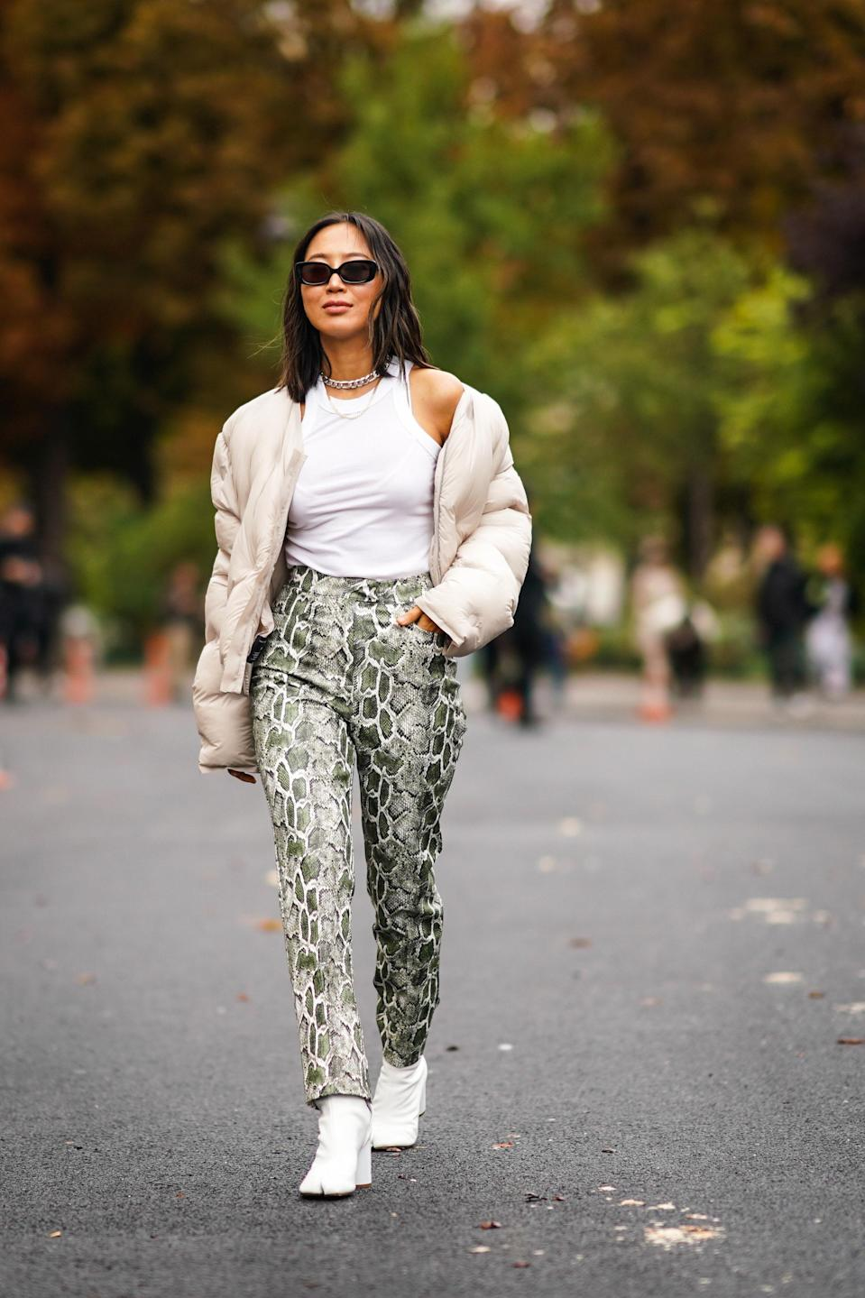"""Everyone has a shirt they wear on constant rotation, but nothing beats the cool factor of <a href=""""https://www.glamour.com/gallery/best-white-tank-tops?mbid=synd_yahoo_rss"""" rel=""""nofollow noopener"""" target=""""_blank"""" data-ylk=""""slk:a tank top"""" class=""""link rapid-noclick-resp"""">a tank top</a>. In addition to being a solid base layer, today's tanks play with the neckline, whether it's through asymmetrical cuts or ultra-thin shoulder straps meant to be shown off on sunny days. Whether you style yours with a pair of comfy <a href=""""https://www.glamour.com/gallery/best-sweat-shorts?mbid=synd_yahoo_rss"""" rel=""""nofollow noopener"""" target=""""_blank"""" data-ylk=""""slk:sweat shorts"""" class=""""link rapid-noclick-resp"""">sweat shorts</a> or layer it underneath a slip dress, no closet is complete without one."""