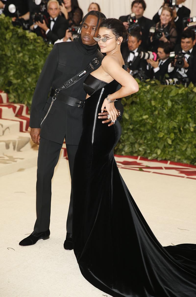 """Travis Scott and Kylie Jenner arrive at the Metropolitan Museum of Art Costume Institute Gala (Met Gala) to celebrate the opening of """"Heavenly Bodies: Fashion and the Catholic Imagination"""" in the Manhattan borough of New York, U.S., May 7, 2018. REUTERS/Carlo Allegri"""