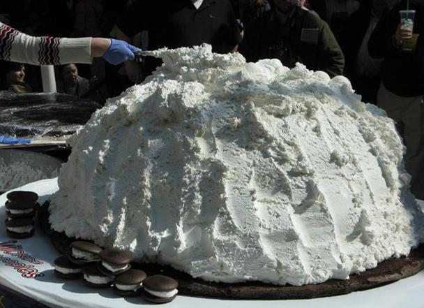 """<div class=""""caption-credit""""> Photo by: RANDALL SMITH</div><b>The World's Largest Whoopie Pie</b> <br> <br> Whoopie pies sparked an interstate battle in 2011 when Pennsylvania and Maine traded bakers' blows over which state is the rightful birthplace of the treat. Enter Amy Bouchard, founder of Farmingdale, Maine's Wicked Whoopies and fabled queen of the form, who sought to settle the score by baking the world's largest: a 1,062-pound, 2,186,700-calorie whopper five times the size of her Pennsylvania rival's. Maine celebrated by naming the soft sandwiched cake its official state treat, second only in standing to the official state dessert, blueberry pie."""
