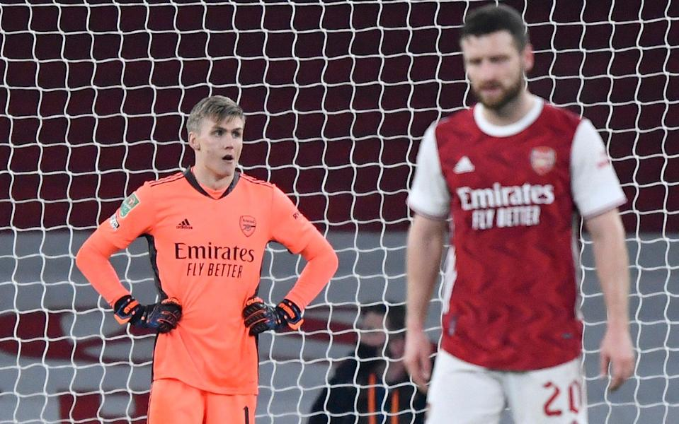 Soccer Football - Carabao Cup - Quarter-Final - Arsenal v Manchester City - Emirates Stadium, London, Britain - December 22, 2020 Arsenal's Runar Alex Runarsson and Shkodran Mustafi look dejected after Aymeric Laporte scored Manchester City's fourth goa - REUTERS/TOBY MELVILLE