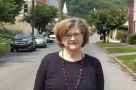 Susan Mazur-Stommen poses for a photo Tuesday, May 18, 2021, in her hometown of Hinton, W. Va. After her son went off to college, Mazur-Stommen was looking for an affordable place to retire. She moved to West Virginia in 2019 with her husband from Washington, D.C. (Ross Spiller via AP)