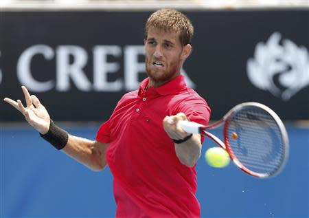 Martin Klizan of Slovakia hits a return to Stephane Robert of France during their men's singles match at the Australian Open 2014 tennis tournament in Melbourne January 18, 2014. REUTERS/Brandon Malone
