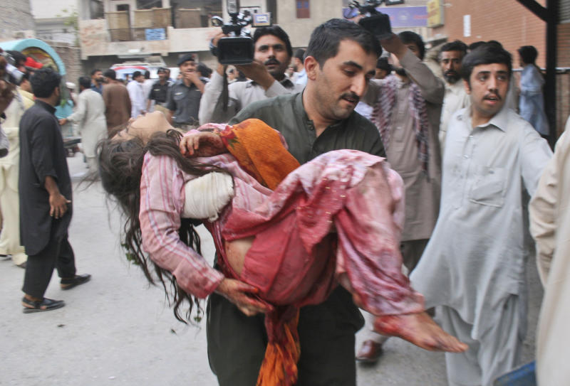 A Pakistani girl, who was injured in an explosion in a Sunni shrine, is rushed to a hospital in Peshawar, Pakistan, Thursday, June 21, 2012. A Pakistani police officer said that two children were killed by the explosion at the shrine as dozens of people gathered there.(AP Photo/Mohammad Sajjad)
