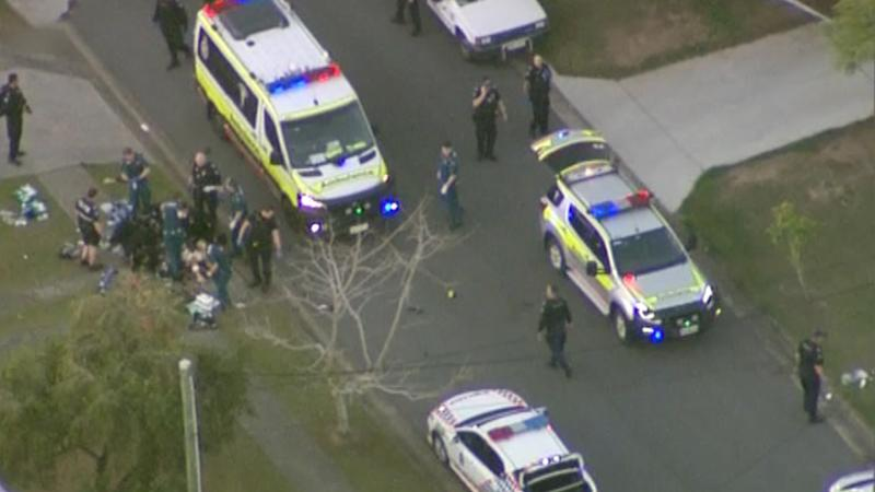 Aerial footage shows paramedics and several police vehicles on the scene.