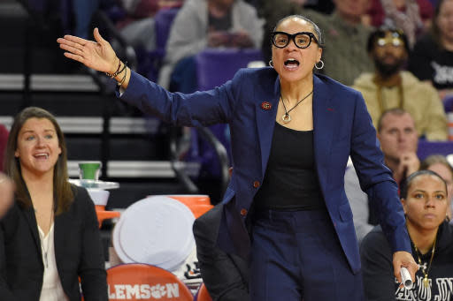 FILE - In this Nov. 24, 2019, file photo, South Carolina head coach Dawn Staley gestures during the second half of an NCAA college basketball game against Clemson in Clemson, S.C. Staley was announced as The Associated Press women's basketball coach of the year Monday, March 23, 2020. (AP Photo/Richard Shiro, File)