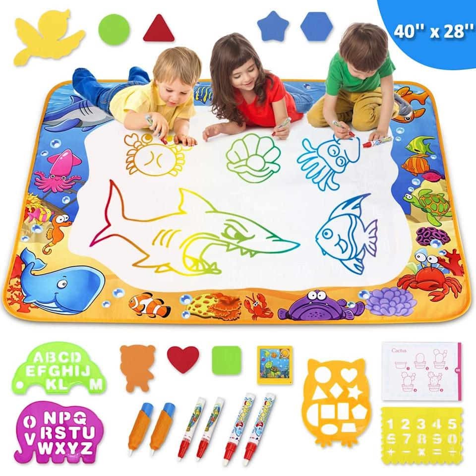 """<p>They can draw everywhere with this <a href=""""https://www.popsugar.com/buy/Toyk-Aqua-Magic-Mat-488258?p_name=Toyk%20Aqua%20Magic%20Mat&retailer=amazon.com&pid=488258&price=23&evar1=moms%3Aus&evar9=26171461&evar98=https%3A%2F%2Fwww.popsugar.com%2Ffamily%2Fphoto-gallery%2F26171461%2Fimage%2F46817833%2FFor-4-Year-Olds-Toyk-Aqua-Magic-Mat&list1=gifts%2Ctoys%2Cstocking%20stuffers%2Cgift%20guide%2Cgifts%20for%20kids%2Ckid%20shopping%2Cgifts%20for%20babies%2Cgifts%20for%20toddlers&prop13=mobile&pdata=1"""" rel=""""nofollow"""" data-shoppable-link=""""1"""" target=""""_blank"""" class=""""ga-track"""" data-ga-category=""""Related"""" data-ga-label=""""https://www.amazon.com/Toyk-Aqua-Magic-Mat-Educational/dp/B07GKWLBN2/ref=sr_1_24?keywords=toys+for+4+year+olds&amp;qid=1567784719&amp;s=gateway&amp;sr=8-24"""" data-ga-action=""""In-Line Links"""">Toyk Aqua Magic Mat</a> ($23).</p>"""