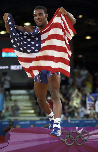 United States' Jordan Ernest Burroughs, celebrates after winning against Iran's Sadegh Saeed Goudarzi after the gold medal match at a 74-kg men's freestyle wrestling competition at the 2012 Summer Olympics, Friday, Aug. 10, 2012, in London. (AP Photo/Paul Sancya)