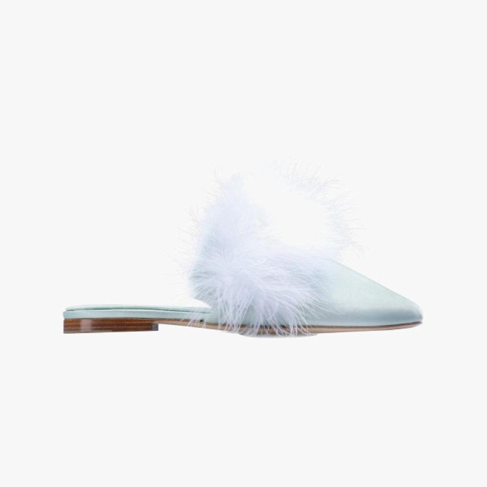 "Bring some whimsy to holiday dressing with Sleeper's feather mules. $290, SLEEPER. <a href=""https://the-sleeper.com/en/product/manon-mules-with-detachable-feathers-in-mint/"" rel=""nofollow noopener"" target=""_blank"" data-ylk=""slk:Get it now!"" class=""link rapid-noclick-resp"">Get it now!</a>"