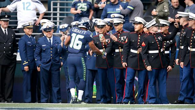 <p>Wide receiver Tyler Lockett #16 of the Seattle Seahawks greets members of the U.S. Armed Services before the start of an NFL game against the Miami Dolphins at CenturyLink Field on September 11, 2016 in Seattle, Washington. (Photo by Otto Greule Jr/Getty Images) </p>
