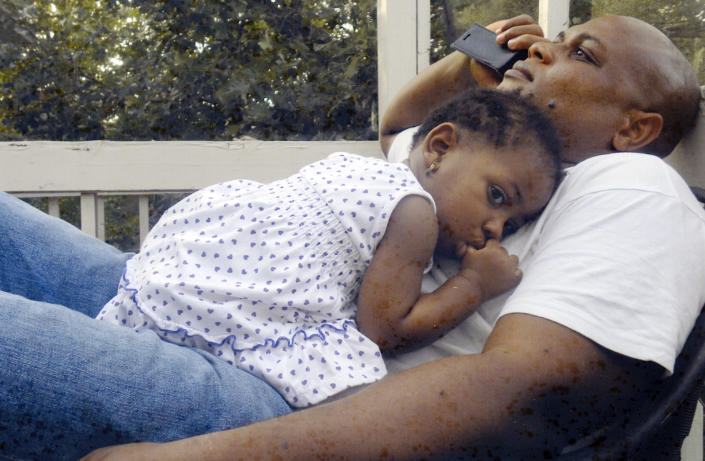 In this undated family photo, Patrick Sawyer is shown with his daughter Ava at their home in Coon Rapids. Sawyer died from Ebola after traveling from his native Liberia to Nigeria. (AP Photo)