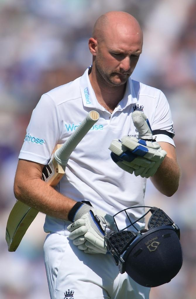 England's Adam Lyth reacts as he walks back to the pavilion having lost his wicket after Australia enforce the follow-on on the third day of the fifth Ashes Test at the Oval on August 22, 2015 (AFP Photo/Glyn Kirk)