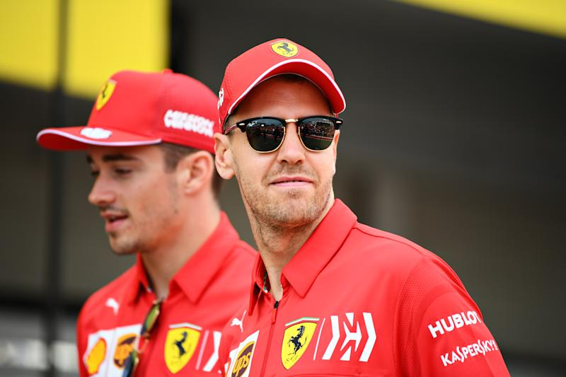 SUZUKA, JAPAN - OCTOBER 10: Sebastian Vettel of Germany and Ferrari and Charles Leclerc of Monaco and Ferrari walk in the Pitlane during previews ahead of the F1 Grand Prix of Japan at Suzuka Circuit on October 10, 2019 in Suzuka, Japan. (Photo by Clive Mason/Getty Images)