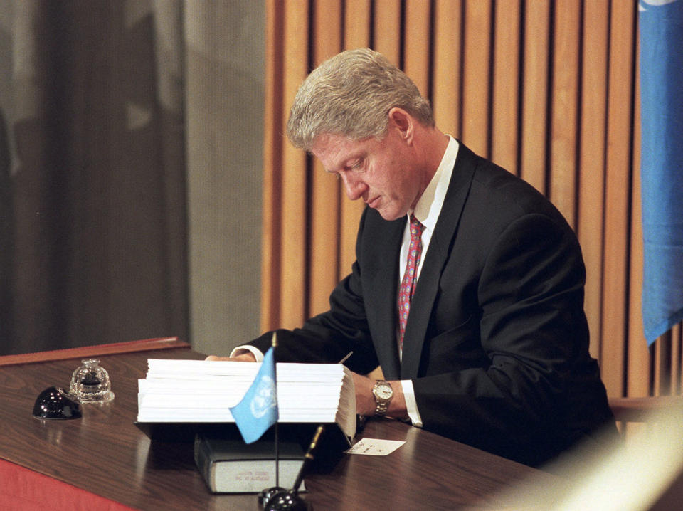 FILE - In this Tuesday, Sept. 24, 1996, file photo, President Bill Clinton signs the historic Comprehensive Nuclear Test Ban Treaty at the United Nations. Nuclear disarmament might seem like a must-discuss topic in world leaders' annual speeches at the U.N. General Assembly, which has espoused that cause since its founding. And the assembly's big annual meeting this Sept. 2021, came in a year that marked the entry into force of one nuclear weapons treaty and the anniversary of another. (AP Photo/Charles Krupa, File)