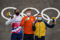 Niek Kimmann of the Netherlands, center, Kye Whyte of Britain, left, and Carlos Alberto Ramirez Yepes of Colombia, right, stand with their medals in the men's BMX Racing finals at the 2020 Summer Olympics, Friday, July 30, 2021, in Tokyo, Japan. (AP Photo/Ben Curtis)