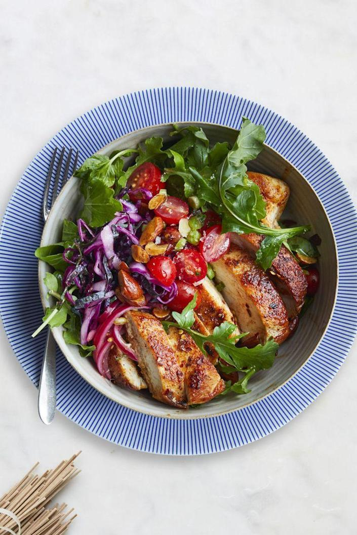 "<p> Spice up your dinner routine with this tasty moroccan chicken bowl. Loaded with a tangy slaw and tomato salad, you definitely won't be missing out on any flavor.</p><p><em><a href=""https://www.womansday.com/food-recipes/food-drinks/recipes/a61042/moroccan-chicken-bowl-recipe/"" rel=""nofollow noopener"" target=""_blank"" data-ylk=""slk:Get the Moroccan Chicken Bowl recipe"" class=""link rapid-noclick-resp"">Get the Moroccan Chicken Bowl recipe</a>.</em></p>"