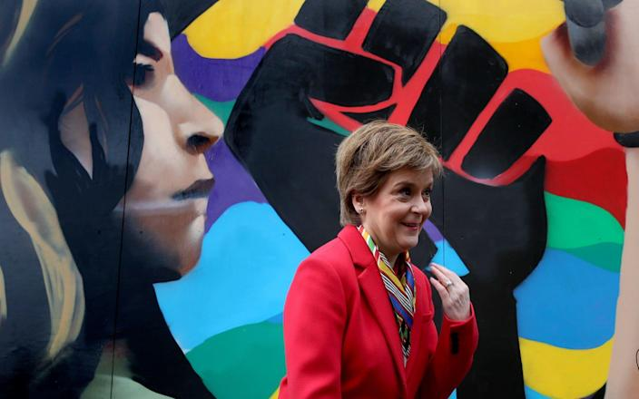 Nicola Sturgeon pictured beside a Black Lives Matters mural in Glasgow, during campaigning for the Scottish Parliamentary election. -  Andrew Milligan/PA