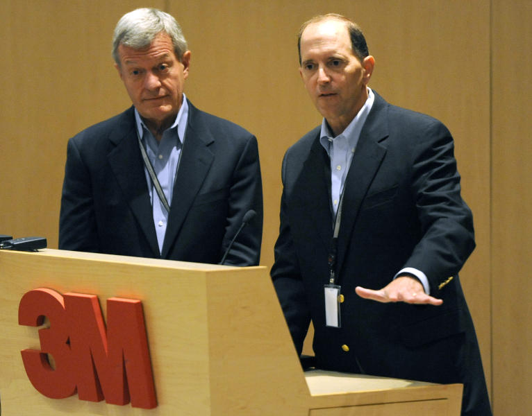 FILE - In this July 8, 2013, file photo Senate Finance Committee Chairman Sen. Max Baucus, D-Mont., left, and the House Ways and Means Committee Chairman, Rep. Dave Camp, R-Mich., talk about tax reform to 3M employees at the 3M Innovation Center in Maplewood, Minn. Two of the most powerful members of Congress, Baucus, a Democrat, and Camp, a Republican, are touring the country to rally support for their effort to overhaul the nation's tax laws.. They've developed a close friendship as they work to attract other lawmakers to their cause while helping Democrats and Republicans get to know each other a bit better. Their secret weapon: burgers and beer. (AP Photo/Hannah Foslien, File)