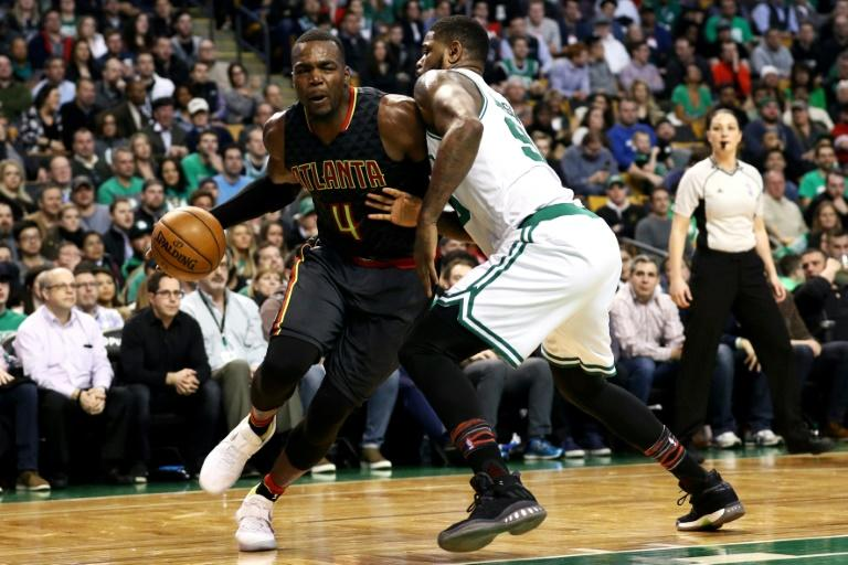 The Celtics, comprehensively beaten by the Cavaliers earlier in the week, slid to another costly defeat as Paul Millsap (L) inspired Atlanta to a 123-116 win