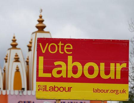 A vote Labour sign is seen near the Gita Bhavan Hindu Temple in Whalley Range, Manchester