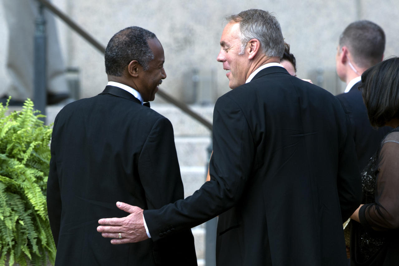 Housing and Urban Development Secretary Ben Carson, left, talks with U.S. Trade Representative Robert Lighthizer as they arrive at the wedding of Treasury Secretary Steve Mnuchin and Scottish actress Louise Linton, at the Andrew Mellon Auditorium in Washington, Saturday, June 24, 2017. (AP Photo/Cliff Owen)