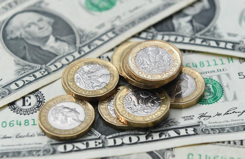 United States dollar bills and UK pound sterling coins.