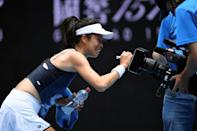 Taiwan's Hsieh Su-wei signed a TV camera after her win over Marketa Vondrousova